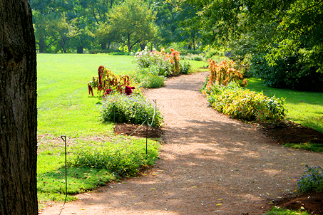 A flowered pathway leading away from the back of Monticello