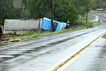 This big rig was ushered off the highway by rushing flood waters