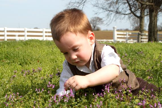 Aspiring Botanist Calvin Turley Examining the Flora in the Rippavilla Front Lawn